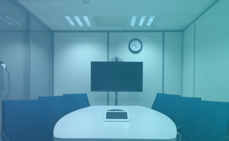 conference room with tv on wall and six seats